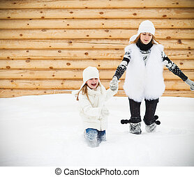 Happy mother with her daughter in a winter day