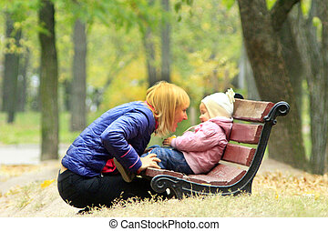 happy mother with her daughter play in the park