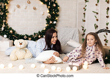 happy mother with her little child daughter playing