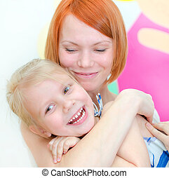 Happy mother with her smiling daughter