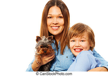 Happy mother with her son and Yorkshire Terrier