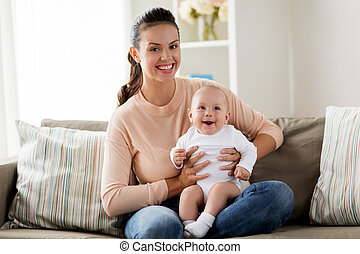 happy mother with little baby boy at home