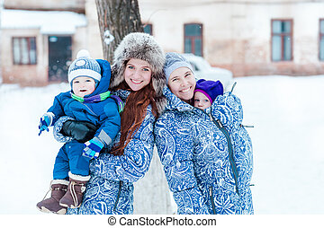 Happy mothers and babys playing on snow
