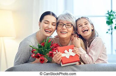Happy mother's day! Child and mom congratulating granny ...