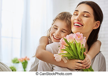daughter congratulates mom