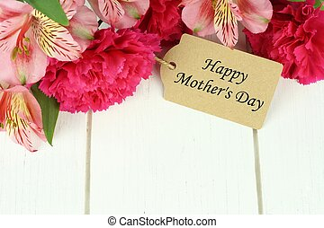 Happy Mothers Day gift tag amongst top border of flowers -...