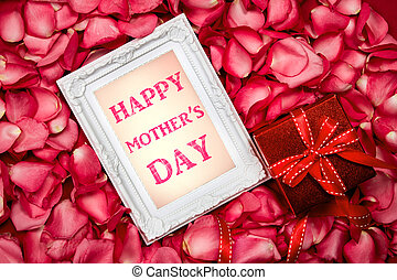 Happy Mother's Day  paper card with the  sweet pink roses  petal and red gift box ,  Love on  Mother's day card concept