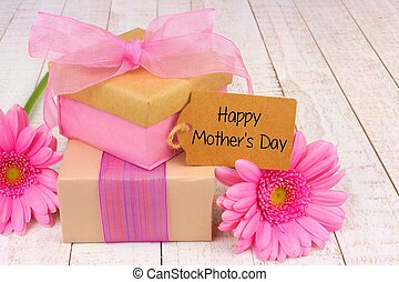 Happy Mother's Day tag, gifts and flowers on white wood