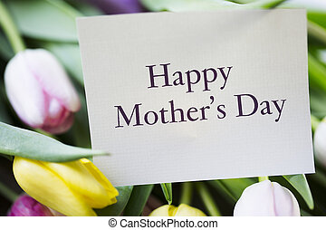 Tulips and card with Happy Mother's day on it.