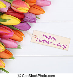 Happy mother's day with colorful tulips flowers and greeting car