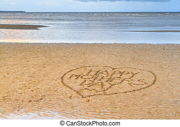 Happy Mother's Day written in the sand