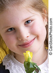 young girl with yellow flowers
