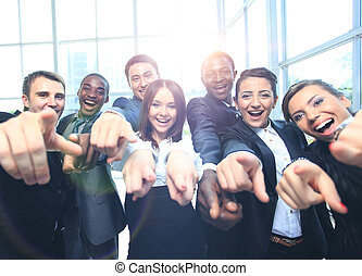 Happy multi-ethnic business team with thumbs up in the...