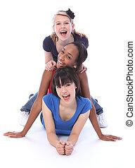 Happy multi ethnic girl friends human totem pole - Human...