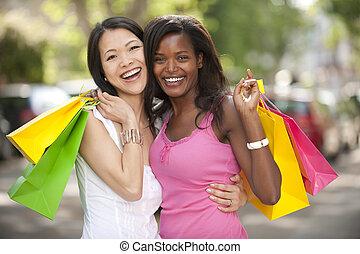 happy multiethnic friends shopping