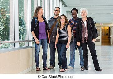 Happy Multiethnic University Students At Corridor