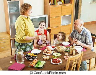 happy multigeneration family having holiday dinner