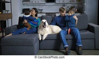 Happy multinational parents with children and dog - Five...