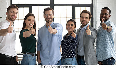 Happy multiracial businesspeople show thumbs up recommending service