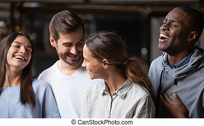 Happy multiracial friends group smiling bonding having fun together