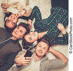 Happy multiracial friends taking selfie