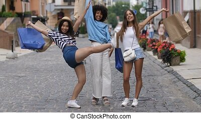 Happy multiracial girls with shopping bags outdoors - Lovely...