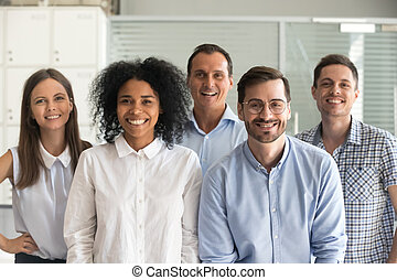 Happy multiracial professional employees looking at camera, team