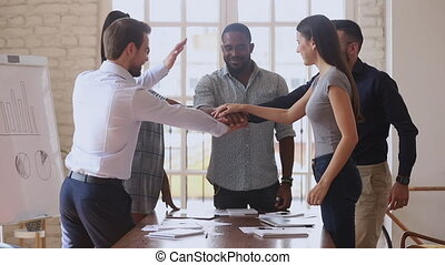 Happy multiracial business team people group stack hands together motivated by corporate success promise partnership union help support in teamwork engaged in team building celebrate victory concept