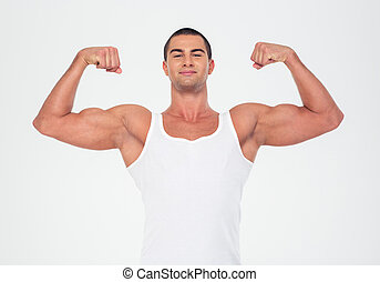 Happy muscular man showing his biceps