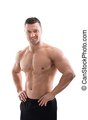 Happy Muscular Man Standing With Hands On Hip