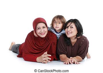happy muslim family lying on floor.