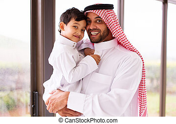 muslim father and son - happy muslim father and son indoors