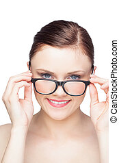Happy natural model looking over her classy glasses