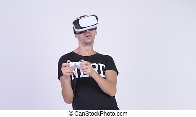 Happy nerd man playing games and using virtual reality...