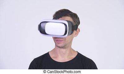 Happy nerd man using virtual reality headset