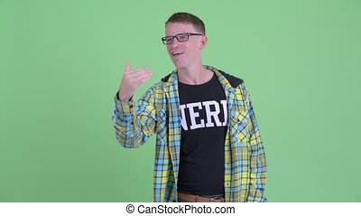 Happy nerd man with eyeglasses waving hand - Studio shot of...