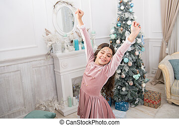 happy new 2020 year. holiday party celebration. christmas home decoration. xmas shopping time. awaiting new year. pretty little princess celebrate christmas. smiling cute child at home. You are next