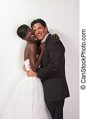 happy new wed interracial couple in wedding mood - smiling...