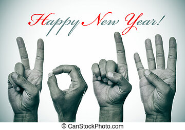 sentence happy new year and hands forming number 2014