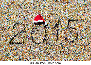 happy new year 2014 with christmas hat on sandy beach -...