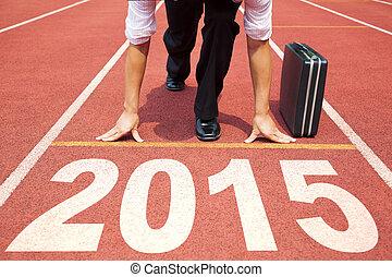 happy new year 2015. businessman preparing for running