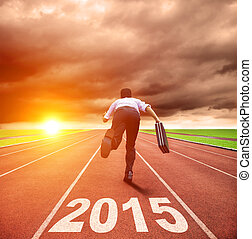 happy new year 2015. businessman running with sunrise background