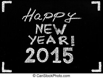 Happy new year 2015, hand writing with chalk on blackboard, vintage concept
