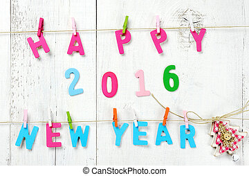 Happy New Year 2016 and christmas tree on wooden background