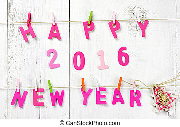 Happy New Year 2016 letters on wooden texture