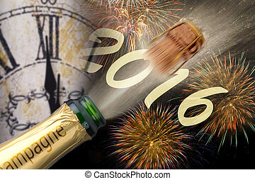 Happy new year 2016 with popping champagne and clock at...