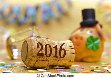Happy new year 2016 with champagne cork and pig as lucky charm