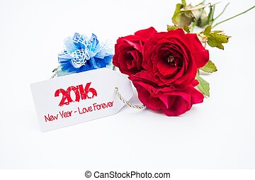 Happy new year 2016 with rose and tag isolated on a white background