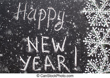 Happy new year 2017, hand writing with chalk on blackboard