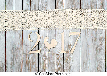 Happy New Year 2017 on wooden background.